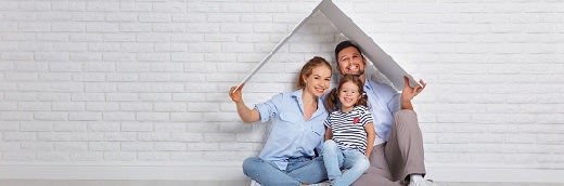 concept housing   young family. Mother father and child in new house with  roof at empty brick wall