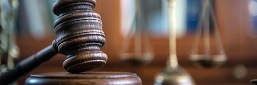 Gavel and scales in a courtroom.