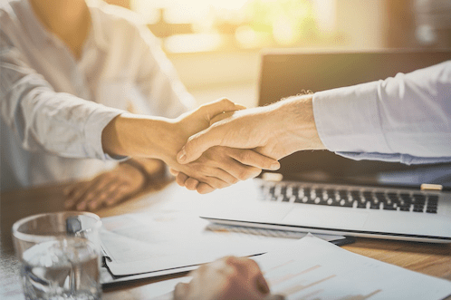 Making a deal for business, shaking hands over a deal