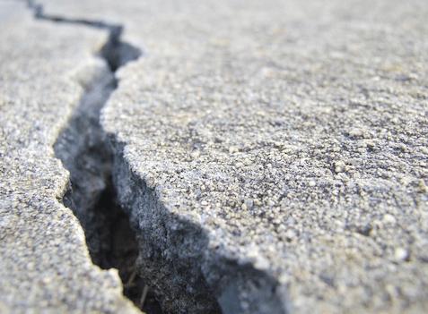 cracked sidewalk or pavement causing danger