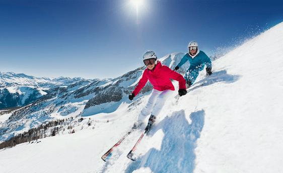 couple skiing down a mountain