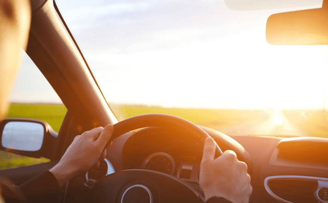 driving car, hands on steering wheel