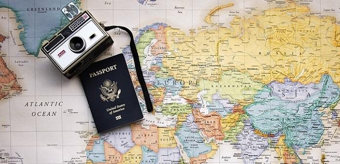 US passport and world travel map