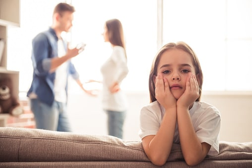 Young unhappy family discussing divorce, child support, and child custody.