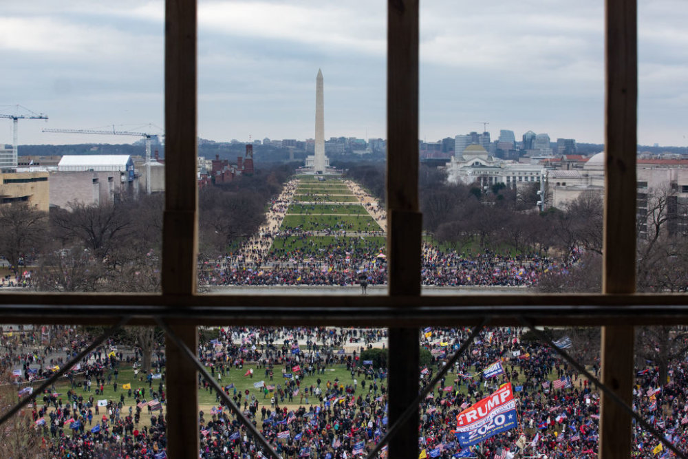 WASHINGTON, DC - JANUARY 06: A crowd of Trump supporters gather outside as seen from inside the U.S. Capitol on January 6, 2021 in Washington, DC. Congress will hold a joint session today to ratify President-elect Joe Biden's 306-232 Electoral College win over President Donald Trump. The joint session was disrupted as the Trump supporters breached the Capitol building. (Photo by Cheriss May/Getty Images)