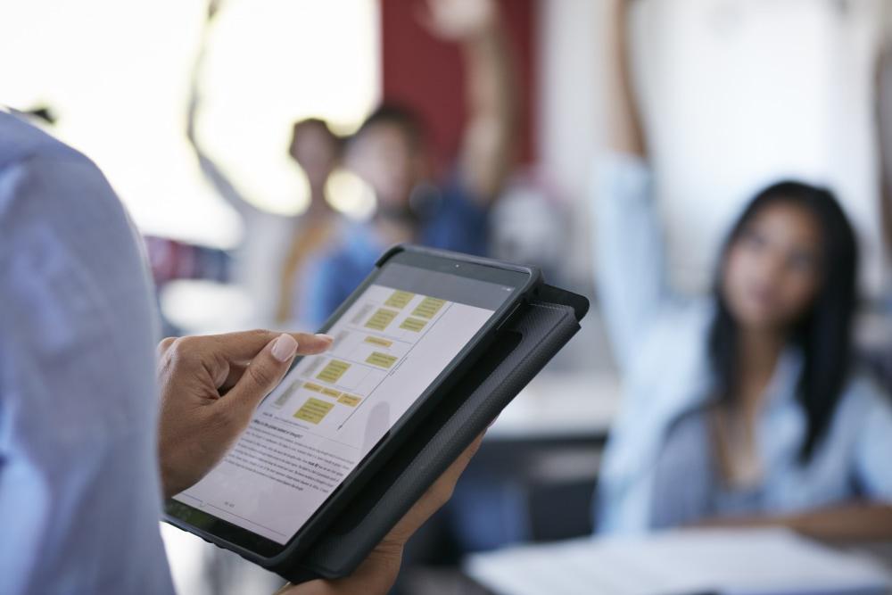 Teacher uses an iPad in a classroom.