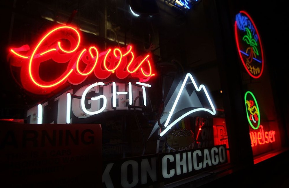 CHICAGO - OCTOBER 9:  A Coors beer sign hangs in a bar October 9, 2007 in Chicago, Illinois. Molson Coors and SABMiller said they will combine their North American operations to challenge the dominance of Anheuser-Busch which holds a nearly 50 percent market share. SABMiller the number 2 U.S. beer seller has about a 20 percent market share and Molson Coors is number 3 with just over 10 percent market share.  (Photo by Scott Olson/Getty Images)