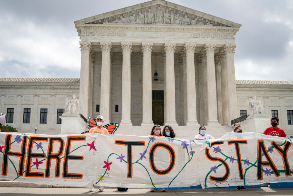 WASHINGTON, DC - JUNE 18: DACA recipients and their supporters rally outside the U.S. Supreme Court on June 18, 2020 in Washington, DC. On Thursday morning, the Supreme Court, in a 5-4 decision, denied the Trump administration's attempt to end DACA, the Deferred Action for Childhood Arrivals program. (Photo by Drew Angerer/Getty Images)