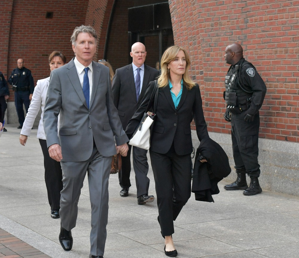 BOSTON, MA - APRIL 03:  Felicity Huffman exits the John Joseph Moakley U.S. Courthouse after appearing in Federal Court to answer charges stemming from college admissions scandal on April 3, 2019 in Boston, Massachusetts.  (Photo by Paul Marotta/Getty Images)