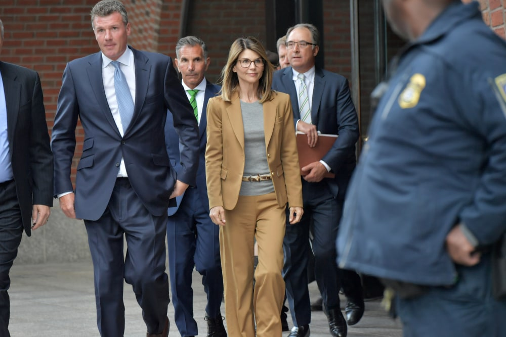 Lori Loughlin exits the John Joseph Moakley U.S. Courthouse after appearing in Federal Court to answer charges stemming from college admissions scandal on April 3, 2019 in Boston, Massachusetts.  (Photo by Paul Marotta/Getty Images)