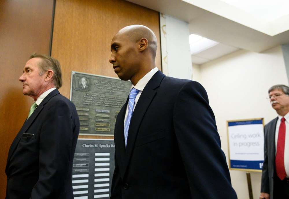MINNEAPOLIS, MN - APRIL 26: Former Minneapolis police officer Mohamed Noor arrives with his legal team at the Hennepin County Government Center on April 26, 2019 in Minneapolis, Minnesota. Noor is charged with second-degree intentional murder, third-degree murder and second-degree manslaughter in the shooting death of Justine Ruszczyk Damond in July 2017. (Photo by Stephen Maturen/Getty Images)