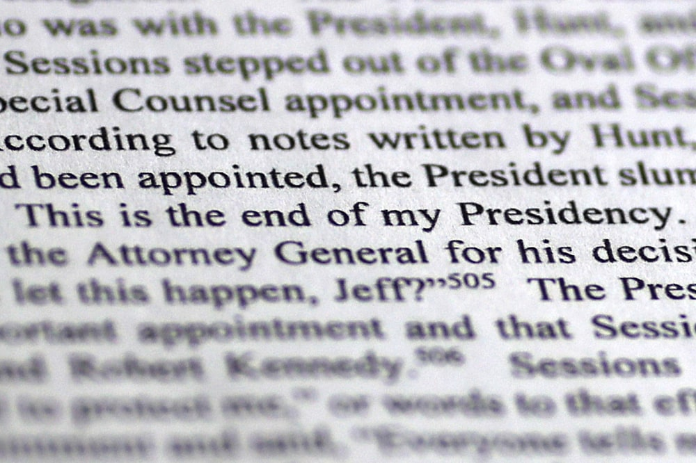 """WASHINGTON, DC - APRIL 18: A page from the recently released Mueller Report is shown April 18, 2019 in Washington, DC. According to a person interviewed by Mueller's team, in response to news from then Attorney General Jeff Sessions that Robert Mueller had been appointed as a Special Counsel to investigate allegations of Russian interference in the 2016 U.S. presidential election, U.S. President Donald Trump said """"Oh my God. This is terrible. This is the end of my presidency."""" (Photo by Win McNamee/Getty Images)"""