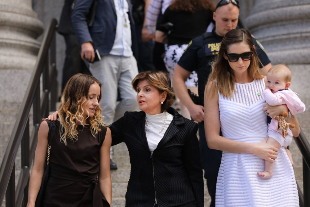 Attorney Gloria Allred (center) leaves a New York court house with two women who publicly accused Jeffrey Epstein of sexually assaulting them on August 27, 2019 in New York City. Their appearance followed a hearing in which U.S. District Judge Richard Berman is to decide whether to officially dismiss charges against the dead financier after the 66-year-old killed himself in a New York jail cell while awaiting his sex trafficking trial. In testimony in front of the judge, over a than a dozen women spoke about how they were sexually abused and trafficked by Epstein at his numerous homes across the country. (Photo by Spencer Platt/Getty Images)