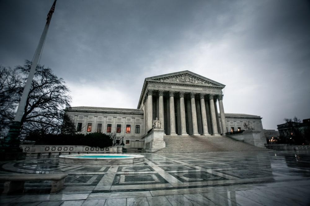 Supreme Court building under clouds
