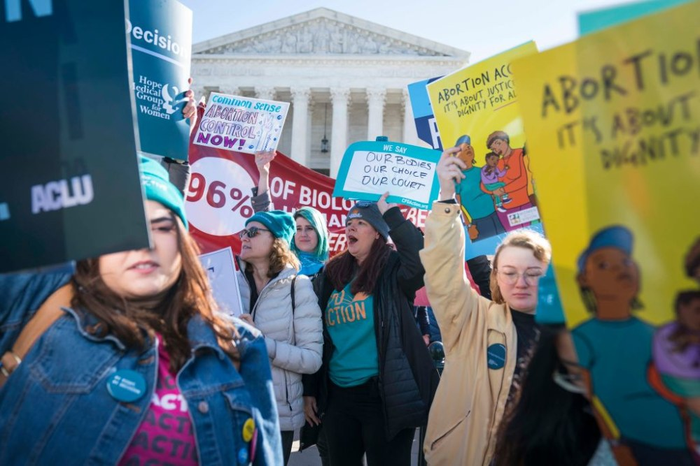 WASHINGTON, DC - MARCH 04: Demonstrators shout slogans and hold banners in an abortion rights rally outside of the Supreme Court as the justices hear oral arguments in the June Medical Services v. Russo case on March 4, 2020 in Washington, DC. The Louisiana abortion case is the first major abortion case to make it to the Supreme Court since Donald Trump became President. (Photo by Sarah Silbiger/Getty Images)