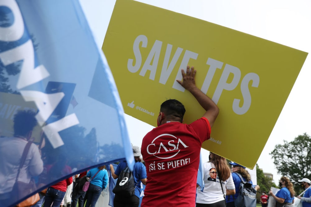 WASHINGTON, DC - SEPTEMBER 15: Supporters of the National TPS Alliance, a grassroots organization made up of immigrant rights groups, rally at the U.S. Capitol following a federal court ruling that threatens the legal standing of thousands of protected residents September 15, 2020 in Washington, DC. The U.S. Court of Appeals for the Ninth Circuit lifted an injunction on the Trump Administration's ability to erase the temporary protected status of 400,000 people from six countries, including El Salvador, Haiti, Honduras, Nepal, Nicaragua, and Sudan. The immigrants, some who have lived in the United States for decades after fleeing civil war and natural disasters, could be deported next year if they do not voluntarily leave the country. (Photo by Chip Somodevilla/Getty Images)