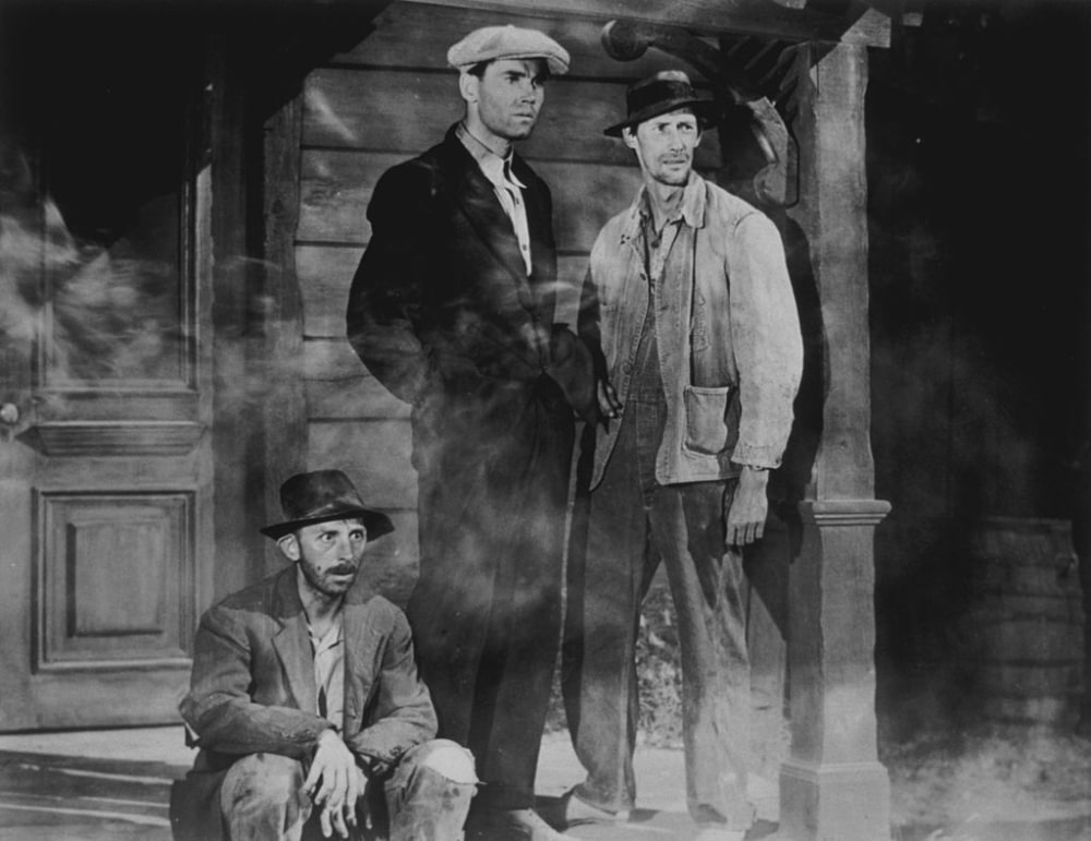 Henry Fonda (1905 - 1982), John Carradine (1906 - 1988) and John Qualen (1899 - 1987) in a scene from John Ford's screen version of John Steinbeck's Pulitzer Prize-winning novel 'The Grapes of Wrath'. Fonda won an Academy Award for his performance and Ford won an Academy Award for best direction.   (Photo by Henry Guttmann Collection/Hulton Archive/Getty Images)