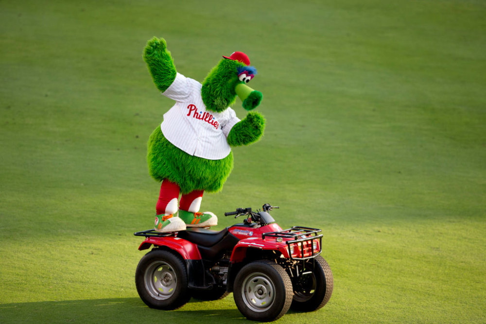 PHILADELPHIA, PA - AUGUST 18: The Phillie Phanatic dances on his ATV prior to the game between the Seattle Mariners and Philadelphia Phillies on August 18, 2014 at Citizens Bank Park in Philadelphia, Pennsylvania. (Photo by Mitchell Leff/Getty Images)