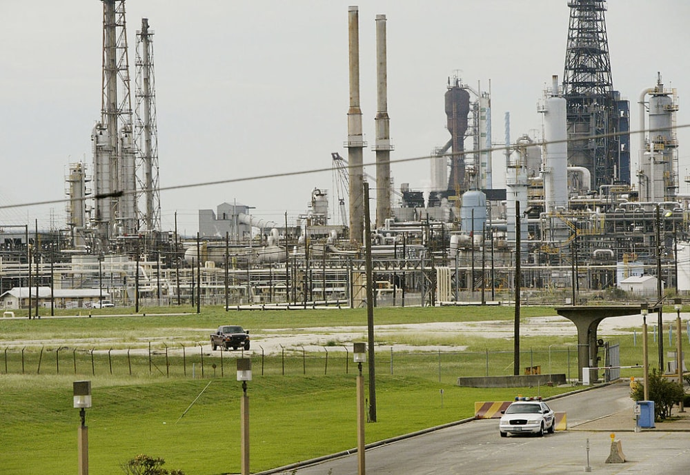 BAYTOWN, TX - SEPTEMBER 23:  A security vehicle sits outside an Exxon/Mobil refinery before Hurricane Rita was expected to make landfall September 23, 2005 in Baytown, Texas. Hurricane Rita is expected to hit the Texas coast near Baytown early morning on September 24.   (Photo by Scott Olson/Getty Images)