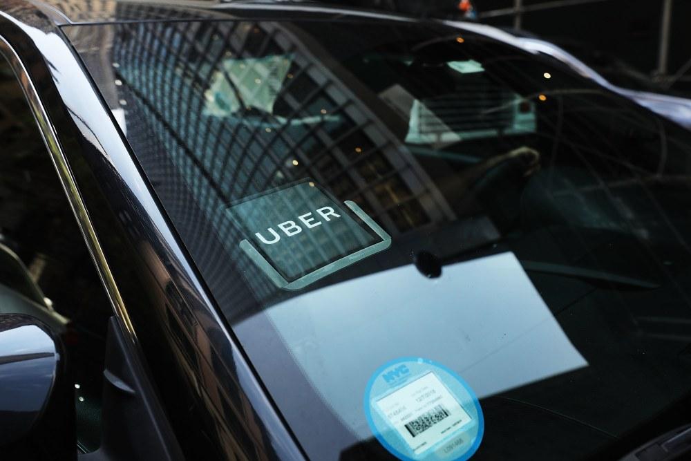 An Uber car waits for a client
