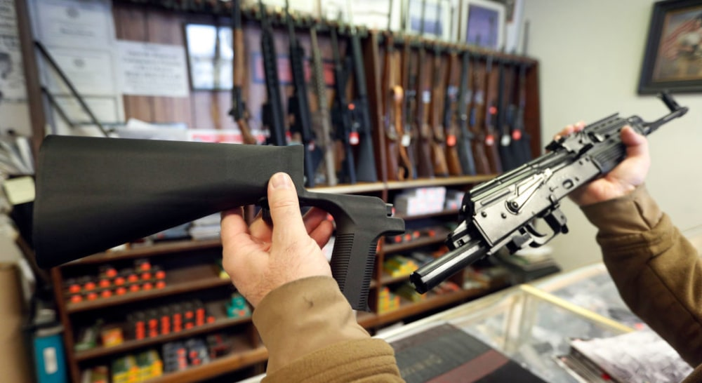 SALT LAKE CITY, UT - OCTOBER 5: A bump stock device, (left) that fits on a semi-automatic rifle to increase the firing speed, making it similar to a fully automatic rifle, is shown next to a AK-47 semi-automatic rifle, (right) at a gun store on October 5, 2017 in Salt Lake City, Utah. (Photo by George Frey/Getty Images)