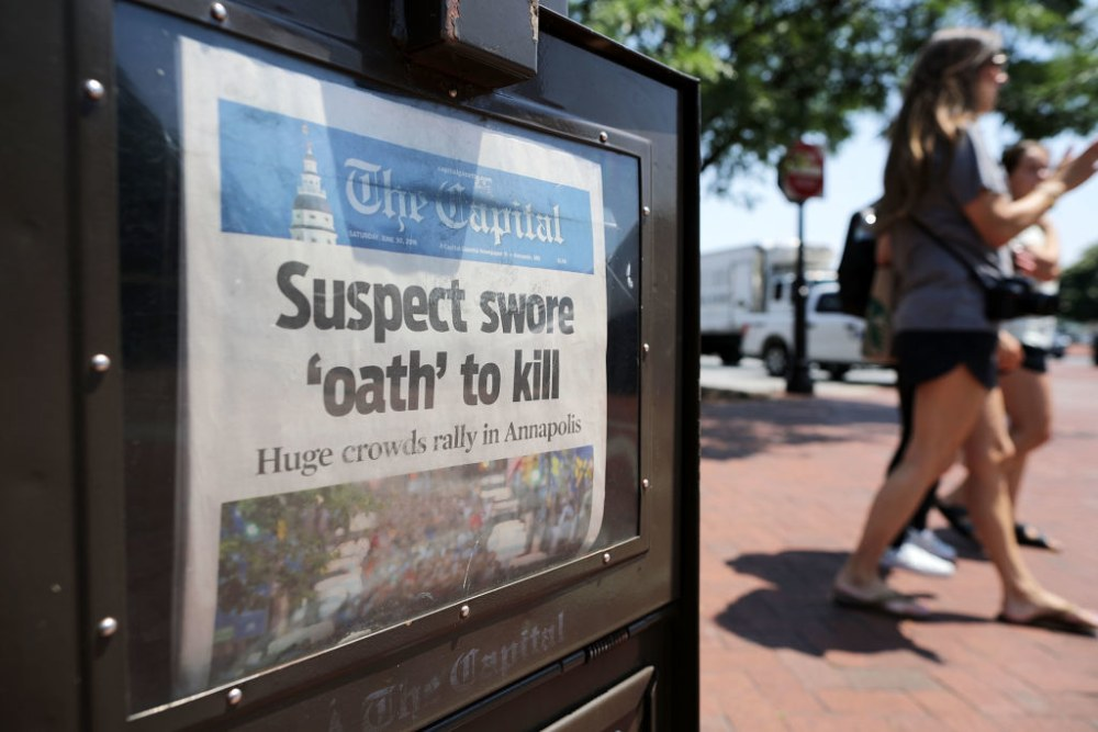ANNAPOLIS, MD - JULY 02:  A newspaper vending machine sells copies of The Capitol, with stories about last week's shooting at the community newspaper's office July 2, 2018 in Annapolis, Maryland. The five victims were Gerald Fischman, 61, an editorial editor; Rob Hiaasen, 59, an editor and columnist; John McNamara, 56, a sports reporter and editor; Wendi Winters, 65, a news reporter and columnist; and Rebecca Smith, 34, a sales assistant. Police arrested Jarrod Ramos, 38, in the paper's newsroom and he is being held without bond on five counts of murder.  (Photo by Chip Somodevilla/Getty Images)