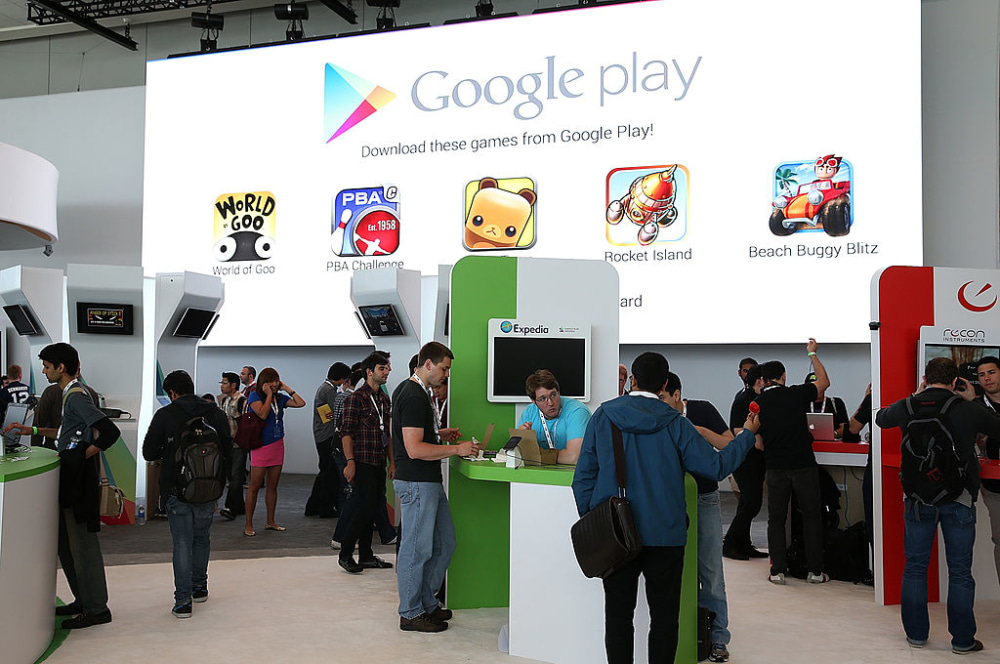 SAN FRANCISCO, CA - MAY 15:  Attendees visit the Google Play booth during the Google I/O developers conference at the Moscone Center on May 15, 2013 in San Francisco, California. Thousands are expected to attend the 2013 Google I/O developers conference that runs through May 17. At the close of the markets today Google shares were at all-time record high at $916 a share, up 3.3 percent.  (Photo by Justin Sullivan/Getty Images)