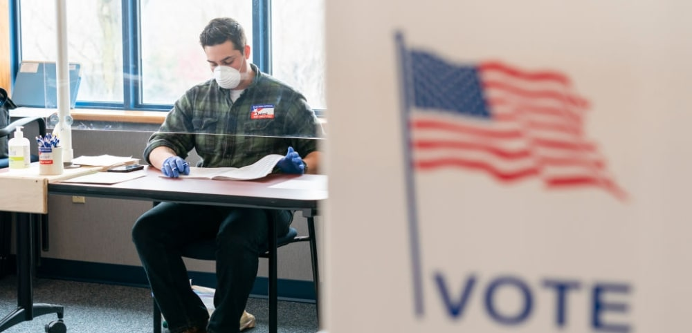 MADISON, WI - APRIL 07: A National Guard member works on election day at a polling location on April 7, 2020 in Madison, Wisconsin. Residents in Wisconsin went to the polls a day after the U.S. Supreme Court voted against an extension of the absentee ballot deadline in the state. Because of the coronavirus, the number of polling places was drastically reduced. (Photo by Andy Manis/Getty Images)