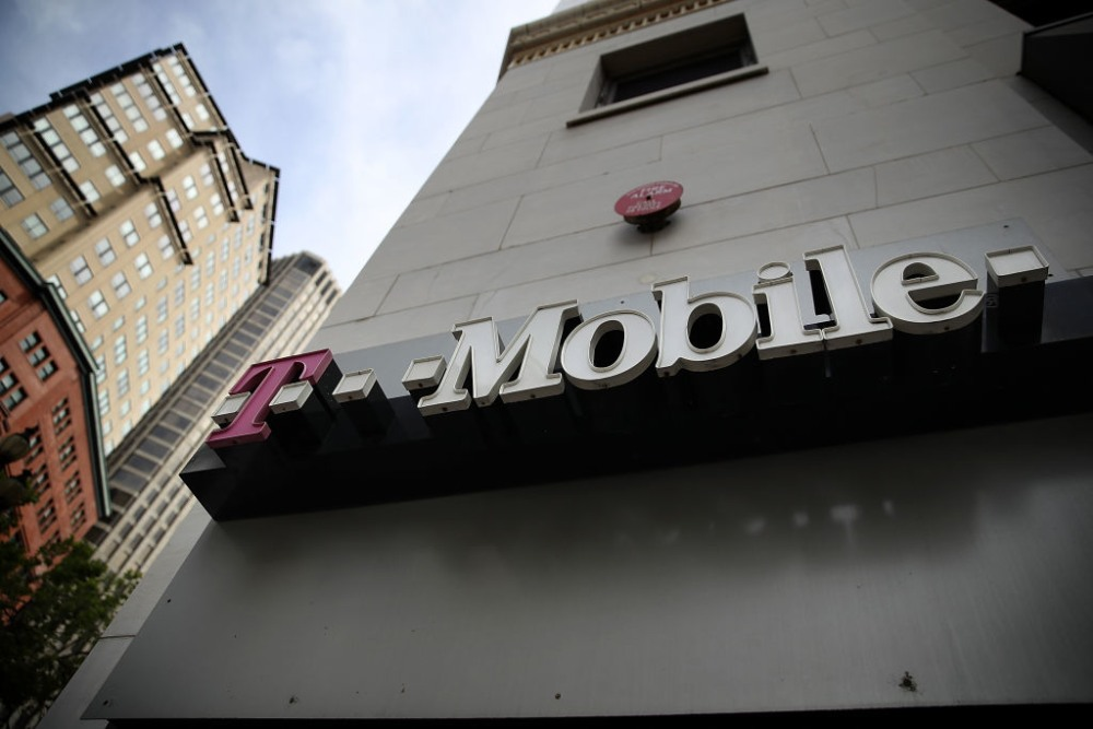 SAN FRANCISCO, CA - APRIL 24:  The T-Mobile logo is displayed outside of a T-Mobile store on April 24, 2017 in San Francisco, California. T-Mobile will report first quarter earnings today after the closing bell.  (Photo by Justin Sullivan/Getty Images)
