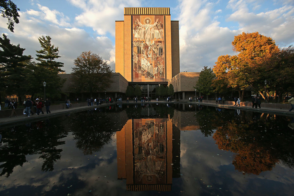 """SOUTH BEND, IN - OCTOBER 19:  A general view of the mural known as """"Touchdown Jesus"""" on the campus of Notre Dame University before the Notre Dame Fighting Irish take on the University of Southern California Trojans at Notre Dame Stadium on October 19, 2013 in South Bend, Indiana.  (Photo by Jonathan Daniel/Getty Images)"""