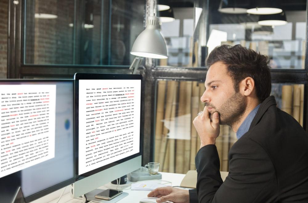 Lawyer-editing-legal-document-on-desktop
