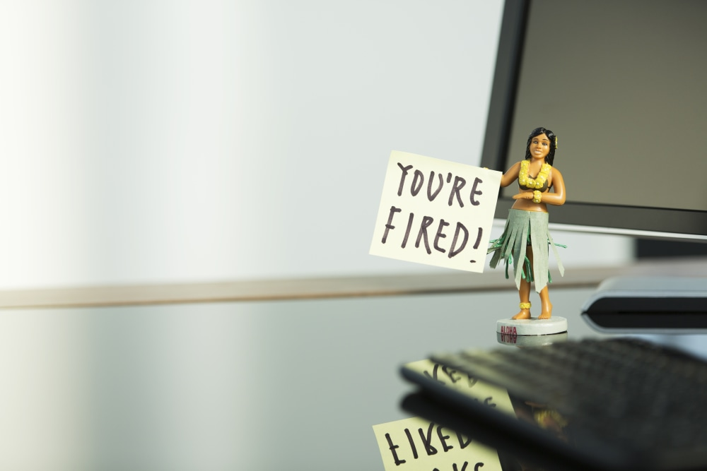 """Statuette on desk with the words, """"you're fired"""""""