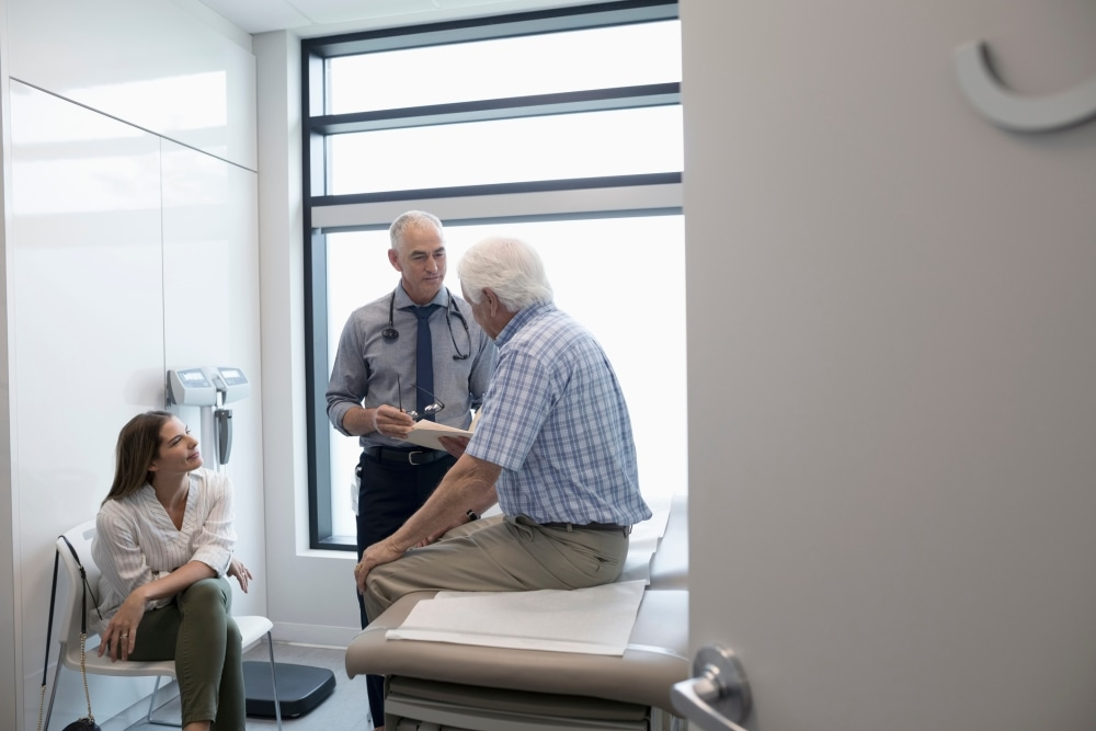 Elderly patient consulting with doctor.