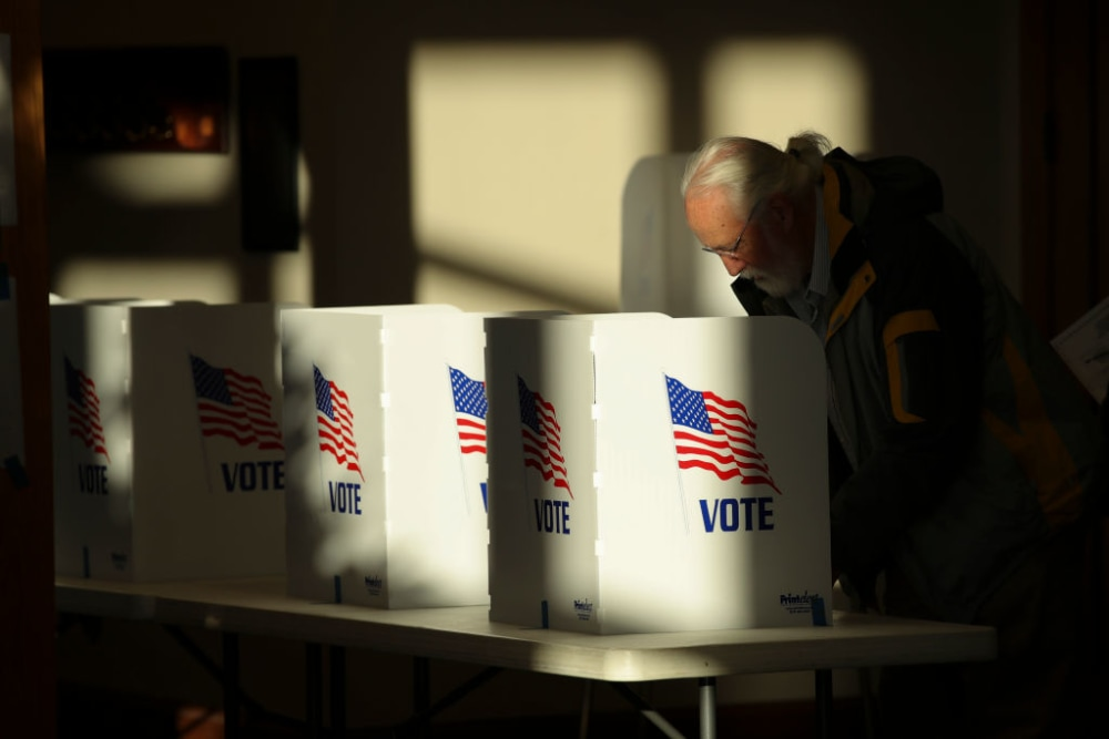 polling place in RIDGELAND, MS - NOVEMBER 27: A voter casts his ballot at a polling place at Highland Colony Baptist Church, November 27, 2018 in Ridgeland, Mississippi. Voters in Mississippi head to the polls for today's special runoff election, where  Democratic candidate for U.S. Senate Mike Espy is running in a close race with appointed Republican Senator Cindy Hyde-Smith (R-MS). (Photo by Drew Angerer/Getty Images)
