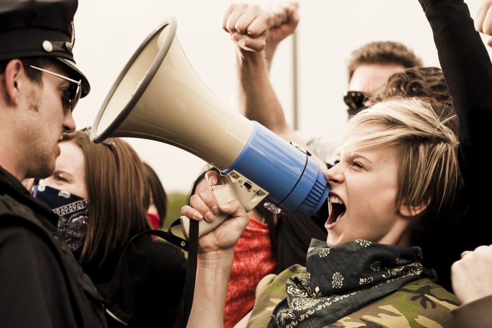 woman-shouting-swearing-at-police-cop