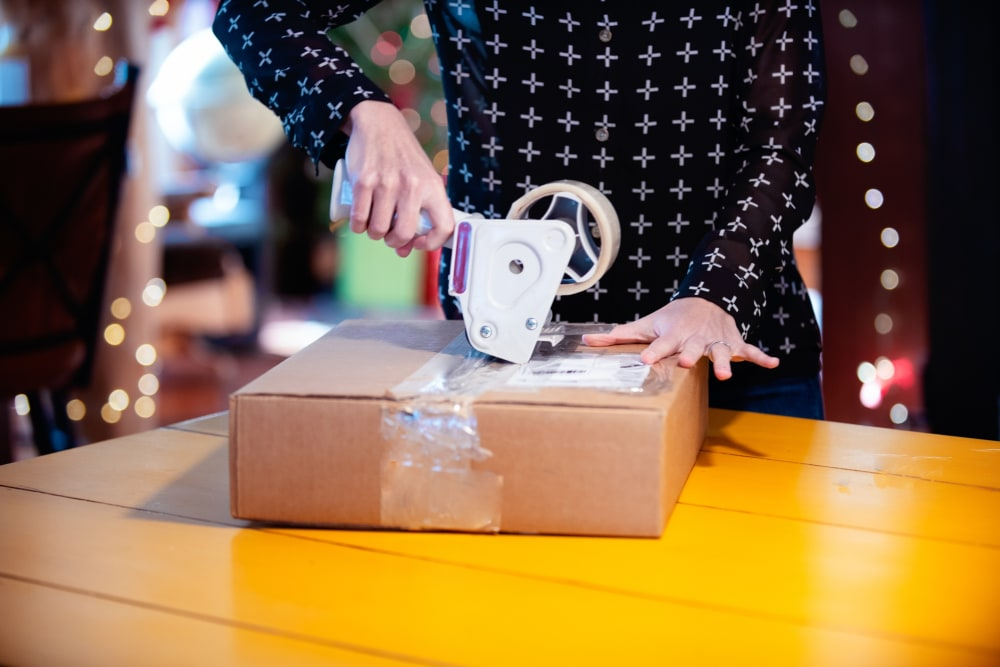 Person packing up a box of returns to send back to company