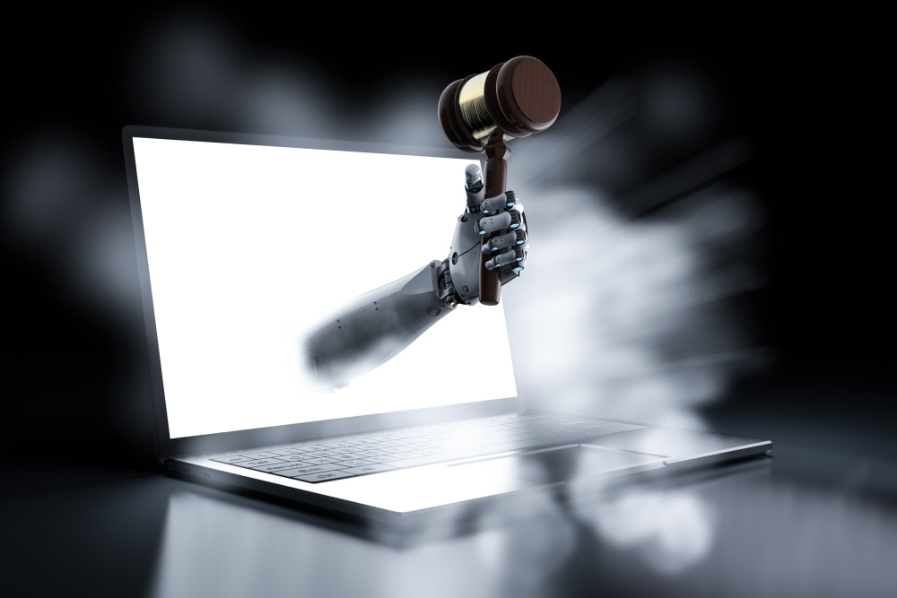 cyber law concept with 3d rendering robotic hand holding gavel judge out of notebook computer