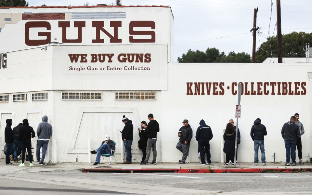 CULVER CITY, CALIFORNIA - MARCH 15: People stand in line outside the Martin B. Retting, Inc. guns store on March 15, 2020 in Culver City, California. The spread of Coronavirus (COVID-19) has prompted some Americans to line up for supplies in a variety of stores. (Photo by Mario Tama/Getty Images)