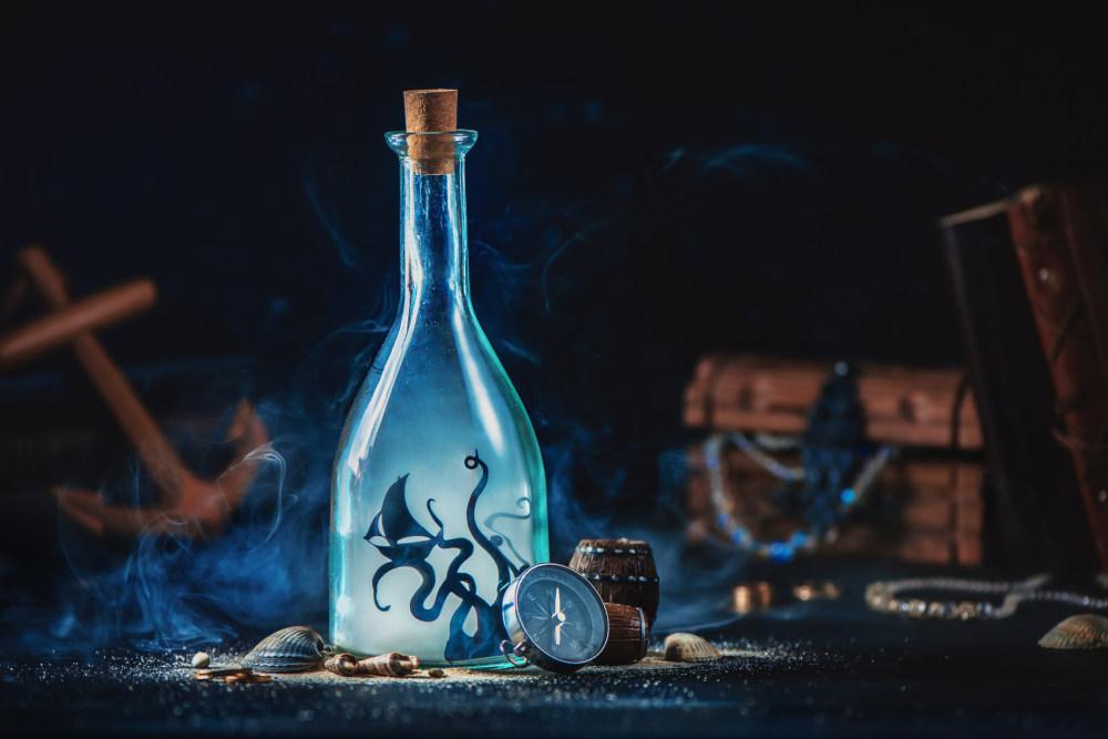 Sea monster, Kraken inside a glass bottle, magical travel still life with copy space