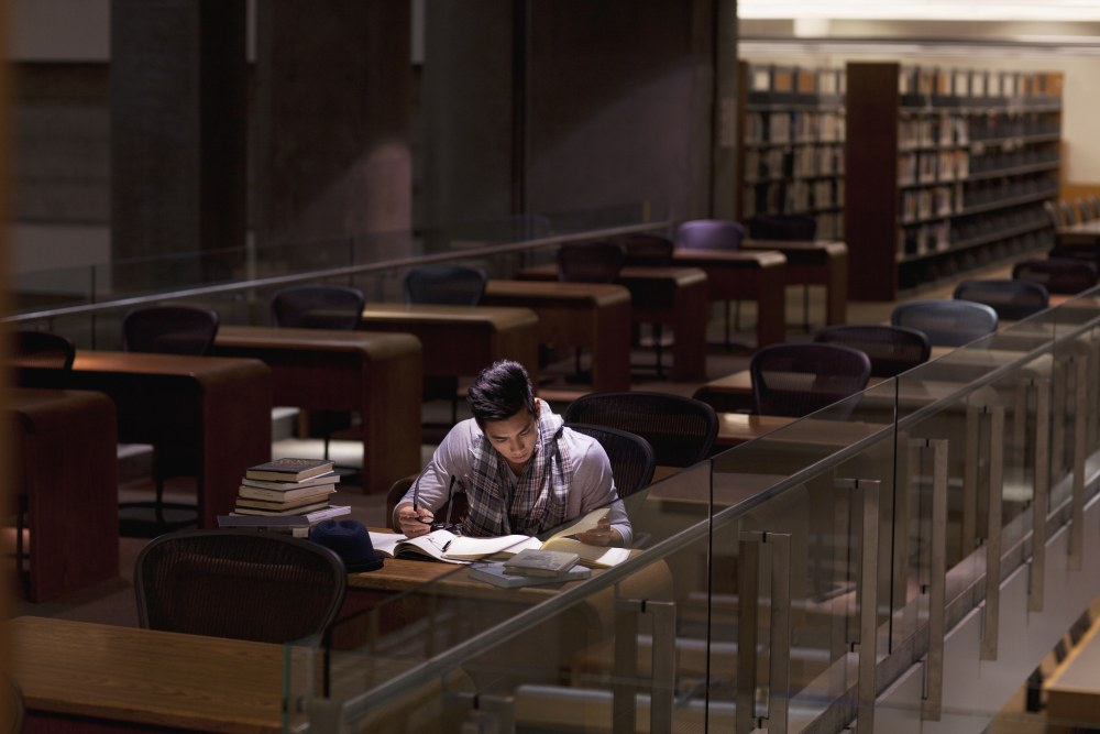 man-studying-library-school