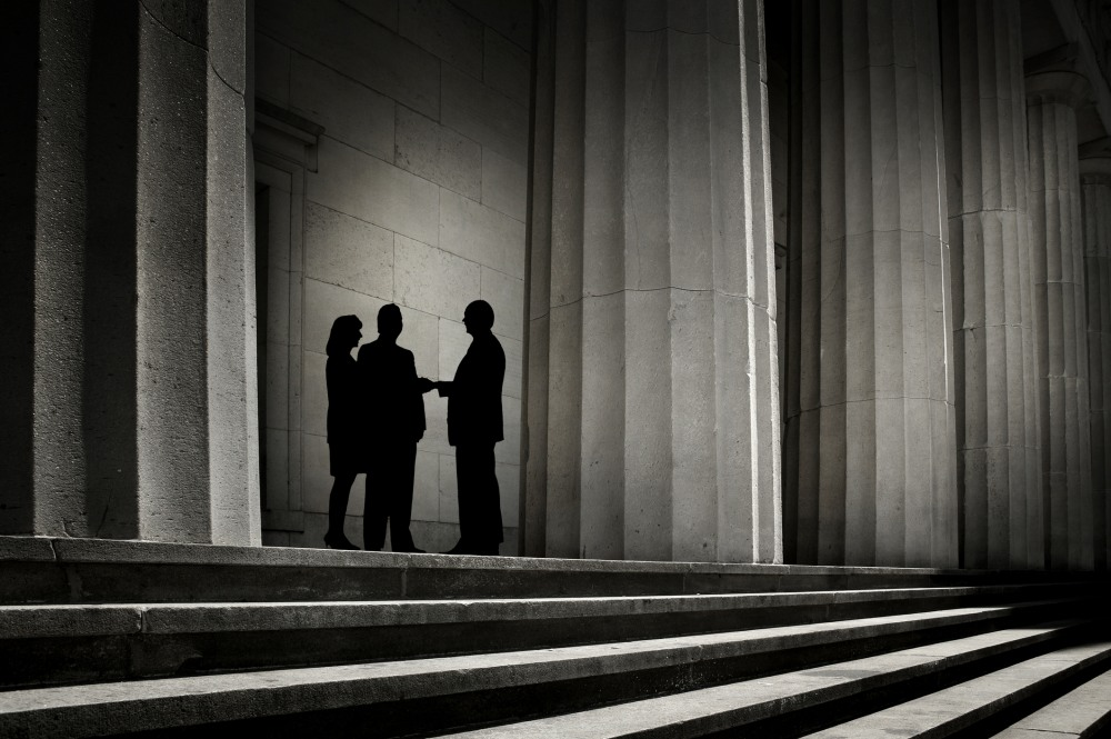"""""""Three people, silhouetted against a backdrop of power, shaking hands.To see more of my financial images click on the link below:"""""""
