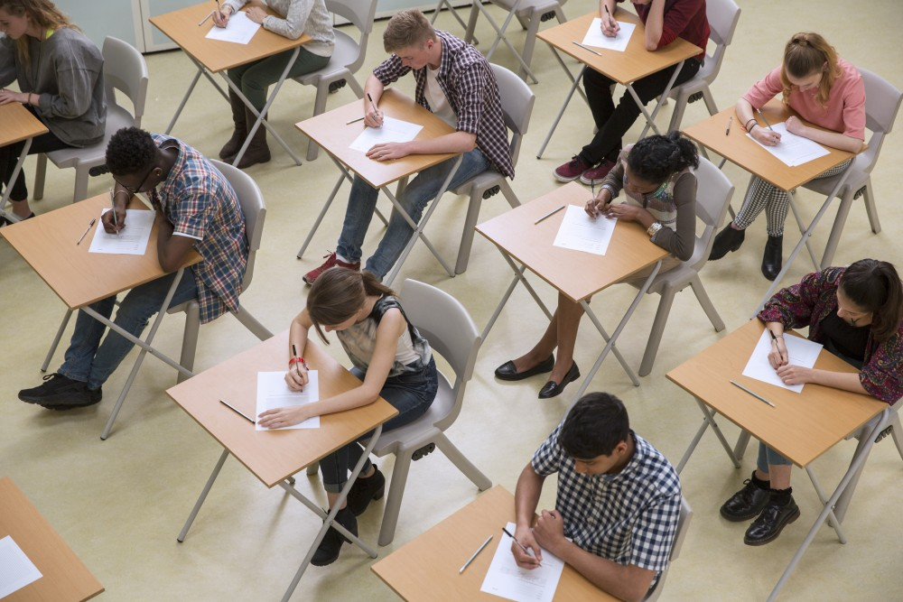 Overhead view of students taking an exam