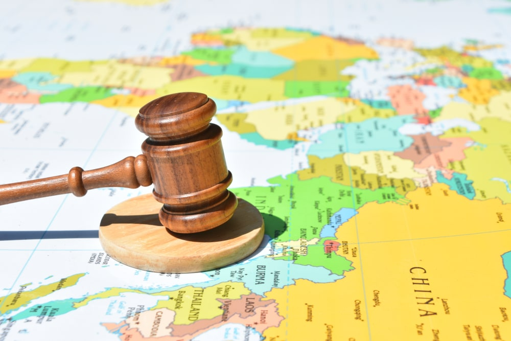 Gavel on world map centered on China