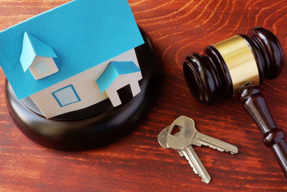 Real Estate Law concept.  Model of house and a gavel.