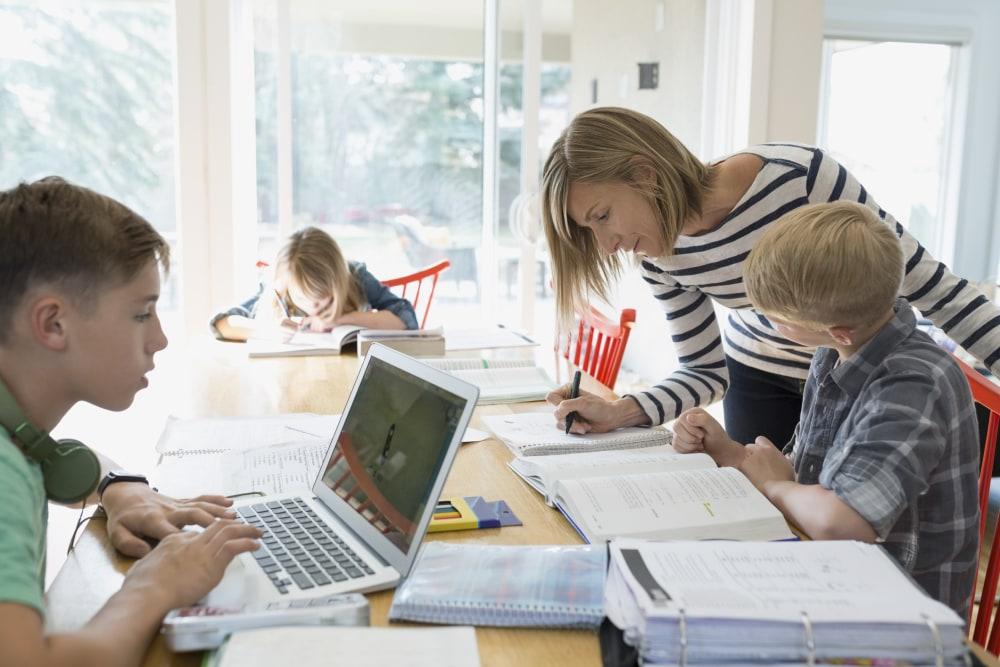 mother-helping-children-homework-homeschool-studying