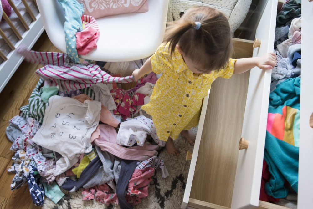 girl-pulling-clothes-from-dresser