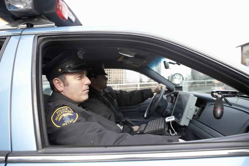 police men in a cop car