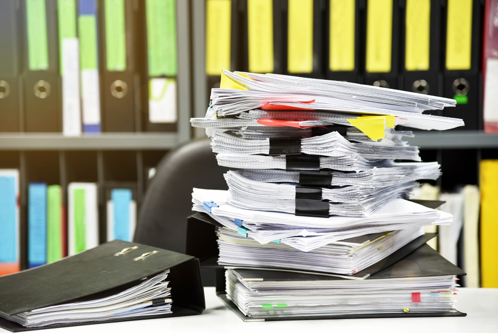 Lot of work, Stacks of document paper and files folder on office desk.