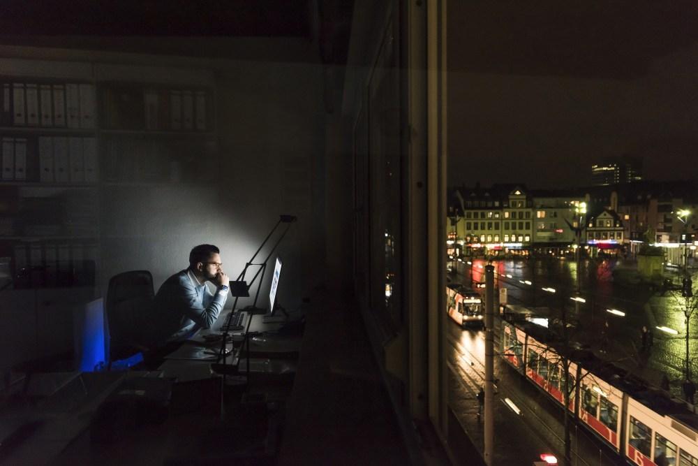 city-night-computer-man-sitting