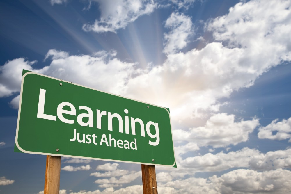 """Sign that reads """"learning just ahead"""""""